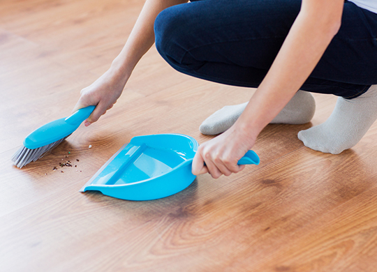 sweeping kitchen floor