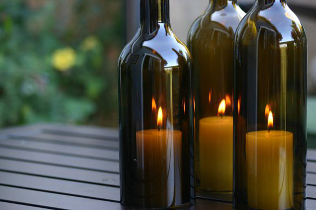 Eight everyday uses for empty wine bottles for Champagne bottle candle holders