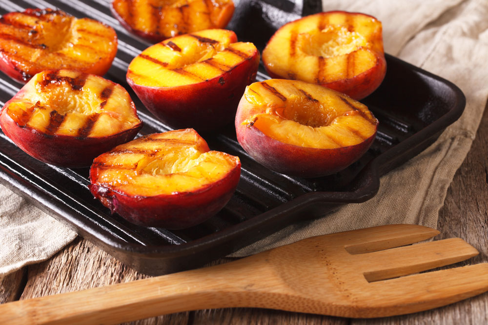 A grilled peach is delicious with a brown sugar glaze.