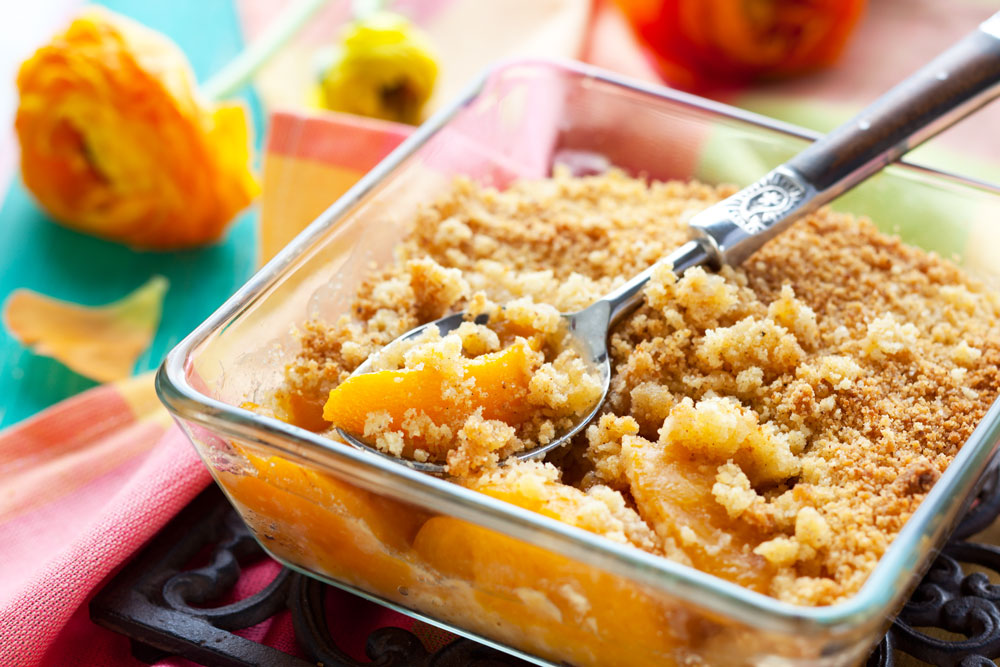 Wholesome peach crisp is topped with oats.