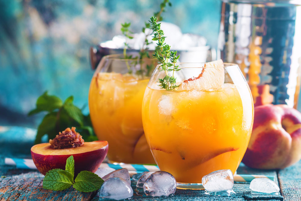 Garnish your peach margarita with fresh herbs.