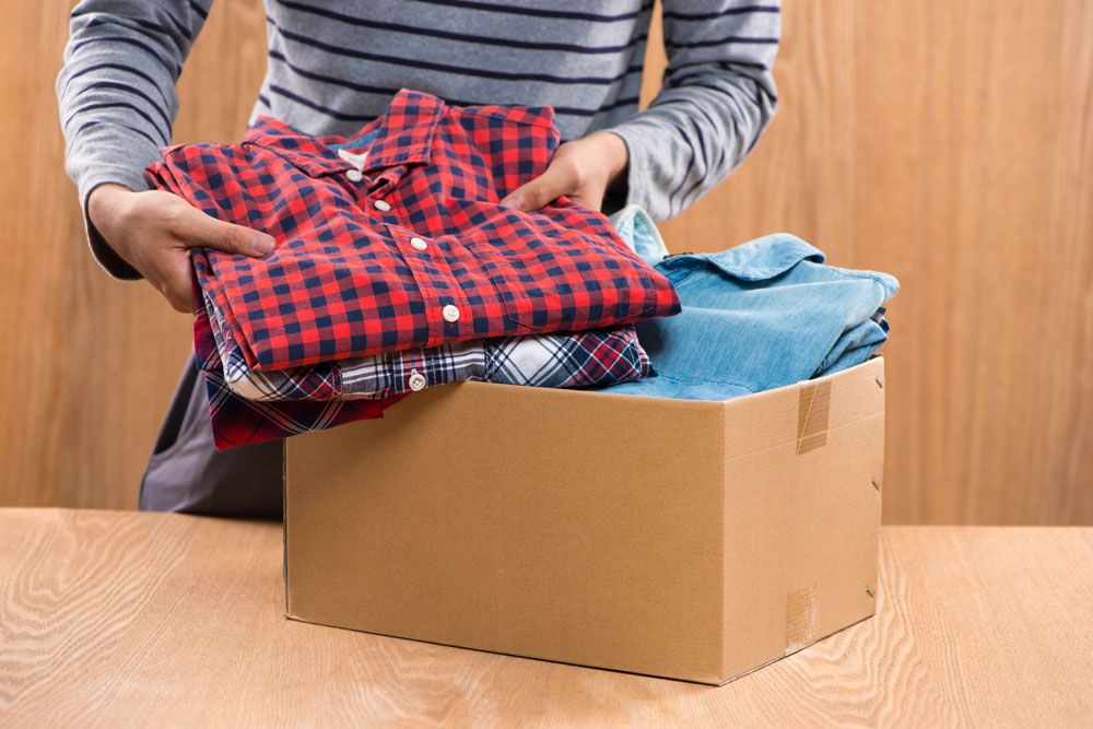 While fall cleaning, pack up unwanted clothing for charity.
